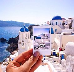 This image of Santorini, Greece is picture perfect! We love how blue the water is and even how it matches the beautiful buildings! This is total vacation inspiration!
