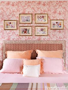 Pattern-filled bedroom. Design: Libby Cameron. Photo: Jonny Valiant. housebeautiful.com #bedroom #florals #wallpaper #pink #orange