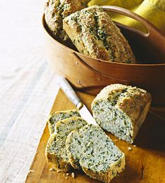 This savory quick bread recipe, flecked with bits of spinach, makes three small loaves. You can also make standard or mini muffins from the batter.