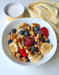 You're going to love this quick, delicious, and customizable Berry Coconut Breakfast Bowl. It's loaded with fresh berries, seasonal fruit, and coconut milk!