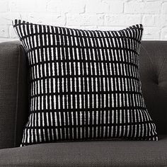 "Shop prim 18"" pillow.   Black lines or white rectangles? Geometric grid forms fun optical illusion with subtle asymmetry.  Featuring flocked black lines, Brooklyn-based designer Aelfie Oudghiri's 100% cotton pillow reverses to solid white."