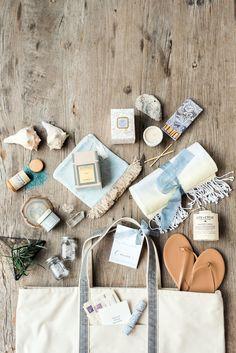 Charleston wedding welcome bag, beach essentials, flip-flops, soap, matchsticks, grey tote bag // Marni Rothschild Pictures