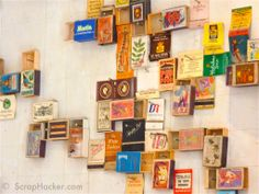 Match Box Wall Collage--what about hanging up postcards or tiny paintings in a similar collection?