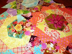 Rose Star Blocks  These are traditionally EPP (English paper piecing), but I like machine piecing them much better!