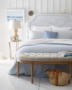 Soft blues and crisp whites make for a blissful bedroom retreat.