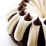 This HERSHEY'S KISSES Bundt Cake is an extremely moist cake loaded with chocolate KISSES inside. It is finished off with a thick cream cheese frosting which compliments the flavor perfectly! #sponsored (direct link in profile)