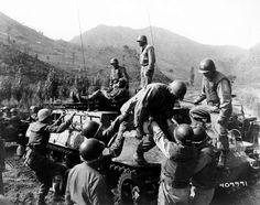 Medical corpsmen of the 1st Battalion Aid Station, 31st Inf. Regt, 7th U.S. Inf. Div., assist in helping wounded infantrymen of Companies D and L, 31st Regiment, following the fight for Hill 598.  14 October 1952.  Kumhwa, Korea.  Signal Corps Photo #1-4885-4/FEC-52-30954 (Sylvester)