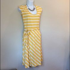 Old Navy Yellow Stripe Cotton Dress Cutie butter yellow dress with tie around elastic waist. Very small mark on left side of chest that was manufacturer default. Cotton. Old Navy Dresses