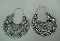 Mazahua Pajarito Hoop Arracadas, by jewelry artist Paulette Avila, via Etsy.