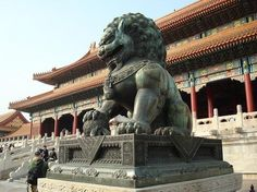 Lion outside the Hall of Supreme Harmony in the Forbidden City by radiowood2000, via Flickr