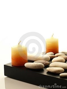 Two spa candles with white stones by Galin Evanov, via Dreamstime