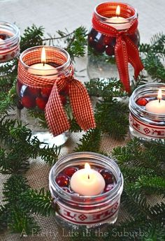 A simple & pretty Christmas table. Love the use of mason jar candles, evergreens and cranberries! I love christmas Mason Jar Christmas Crafts, Noel Christmas, Christmas Candles, Christmas Centerpieces, Mason Jar Crafts, Country Christmas, Christmas Projects, Holiday Crafts, Christmas Decorations