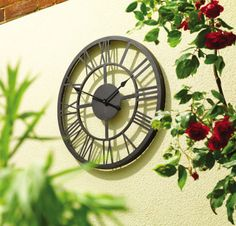 Create a stylish focal point for your home or garden with this stunning architectural clock.A traditional style, large Roman Numeral clock, this piece has a contemporary finish and looks fantastic in an outdoor or indoor setting. The eye catching design is crafted with a durable metal frame and finished in black with large pierced metal Roman Numerals. Please note that this clock requires 1 x AA battery which is not supplied.Metal56cm diameter