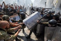 Police fired tear gas at protesters this morning before a grenade was thrown outside the parliament buildings, Ukraine.