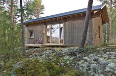 """dezeen: """"This small wooden cabin by London-based architect Sini Kamppari perches among trees on a granite ridge, offering views of a lake in southeast Finland » """""""