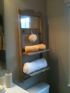 old wooden folding chair, cut seat in half and attach half to lower rung of chair and add mirror to back and hooks, awesome.