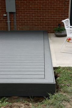 Photo 7- grey Trex type decking material. See small screw holes in large image