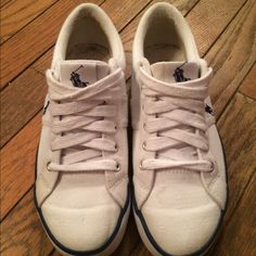 Ralph Lauren sneakers Navy and white RL Polo canvas sneakers. Only worn 2 or 3 times. Fit more like a 7.5 Ralph Lauren Shoes Sneakers