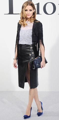 Olivia Palermo also took her seat at the Dior 2015 Cruise show in an embroidered organza print white blouse with an embroidered lambskin leather skirt, a bejeweled clutch, blue pumps, and a cool floral ear cuff—all by Dior. And she gave the look her famous Palermo touch and topped it off with a fringe jacket and a bangle.