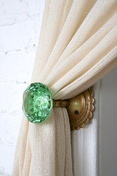 glass door knob curtain tie-backs. love this idea!
