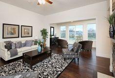 Transitional Living Room with flush light, High ceiling, Carpet, Ceiling fan, Hardwood floors
