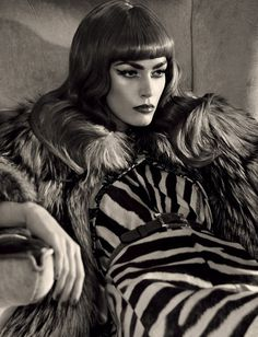 The Glamorous Life: Patrycja Gardygaijo is art deco queenly vamp in 'Glamorous Life', shot by Dirk Messner for Harper's Bazaar Hong Kong's June issue. Styled by Jennifer Hahn, Patrycja slips into the luxurious, thirties imprints of Versace, Prada, Giambattista Valli, Burberry Prorsum and more in this mostly red, black and gold editorial. /Hair by Anja Fichtenmayer; makeup by Natalie Franz