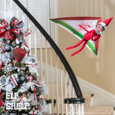 This scout elf is experimenting with other ways to fly after a long flight from the North Pole! | Elf on the Shelf Ideas