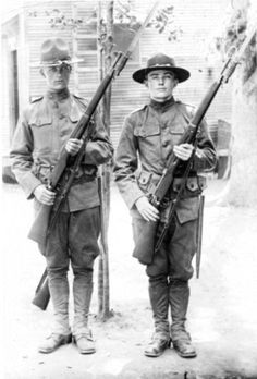 M1917 Enfield Rifle...Two American soldiers at port arms with their US Rifle, Cal. .30, M1917 Enfield with the large rear sight and M1917 bayonet with the two parallel grooves in the grips. Photo and description: Dan Morrison.