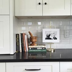 One way to display cookbooks! When your toaster and coffeemaker is hidden away you can install an easel with grandpa and oldest son Kitchen Buffet, Kitchen Display, White Kitchen Cabinets, Kitchen Decor, Kitchen Design, Cookbook Display, Shabby Chic Kitchen, Apartment Living, Home Renovation