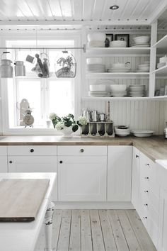 White kitchen with open shelving.