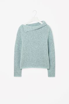 Made from soft wool-mix with a comfortable stretch, this jumper has a tactile boucle knit and draped folded collar. Wide-cut for a loose, oversized fit, it is a cropped style with long sleeves and cleanly finished edges. NICE SUITABLE FOR EVERY SKIRT