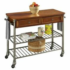 """Perfect for stowing dishware, cooking tools, and dry ingredients, this versatile kitchen cart showcases a castered base, 2 open metalwork storage racks, and 2 drawers.  Product: Kitchen cartConstruction Material: Metal and engineered woodColor: Gunmetal and naturalFeatures:  Two storage racksTwo drawersTwo towel racks Two slated shelvesDimensions: 36"""" H x 45"""" W x 20"""" D"""