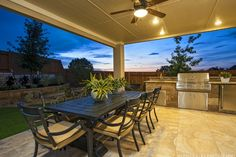 Enjoy the cool #summer evenings on your #covered #outdoor #patio with a built-in #bar and #grill at Travisso. #backyard #dining