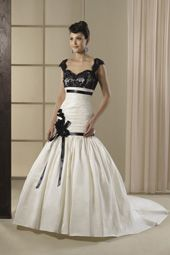 Angel & Tradition wedding dress/gown- ivory and black trumpet style wedding dress with black lace overlay bust, pleated skirt, black bow detail, and sweetheart neckline. For the Bride Boutique Ft. Myers, Florida