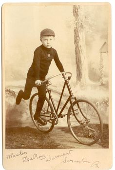YOUNG BOY ON EARLY 1880S BICYCLE