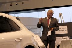 Porsche Manager Ray Forster points out the many features of the new Macan Single Breasted, Porsche, Suit Jacket, Product Launch, Jackets, Fashion, Autos, Down Jackets, Moda