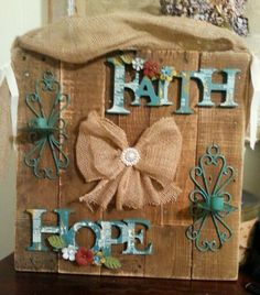 DYI home decor from pallet wood with different things mounted on it and a burlap ribon for hanging.