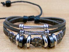 Mens leather wristbands personalized bracelets Punk style unisex Surfer Cuff Leather Rope Bracelet Bead Metal flower Bracelet. $7.99, via Etsy.