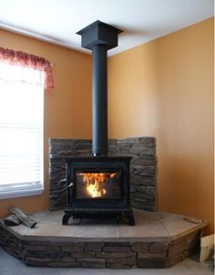 stone tile wood stove surround - less expensive option Wood, Home, House Styles, Wood Stove Fireplace, Hearth, Wood Burner, New Homes, Wood Heat, Wood Burning Stove Corner