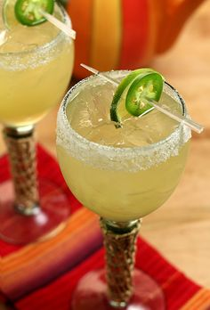 JALAPENO MARGARITA  - Lime quarter for rim  - Salt and sugar evenly mixed for rim  - 4-6 slices fresh jalapeno (I used 4 since I was also using jalapeno tequila; adjust according to your taste)  - 2 oz lime juice  - 2 oz agave nectar  - 2 oz orange liqueur  - 4 oz tequila (as mentioned, mine was jalapeno infused but it's not required)