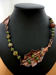 I made an asymmetrical necklace with the handmade copper leaf by Ms. Sonya nicely draping the neck.