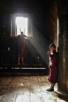 Photograph Sunrays onto young monk by Spencer Tan on 500px