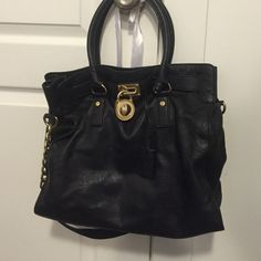 FINAL PRICE! Michael Kors Hamilton Bag Black bag, long strap, 100% authentic can post more pictures by request for authenticity. Please refer to all pictures. No trades! It is the soft leather. Comes with the key to unlock the lock Michael Kors Bags Shoulder Bags