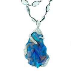 Katherine Jetter Whitsunday Pendant This rare 34.53ct Solid Lightning Ridge Black Opal is set in 18K White Gold Pendant with Diamonds and hangs from an 18K White Gold and Moonstone chain.