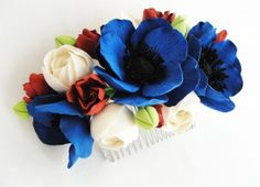Flowers comb. Handmade. All flowers are made completely by hand from Claycraft by deco - air dry clay that is soft, durable and lightweight, non toxic. Keep it up from water or liquids. The flowers requires careful handling.