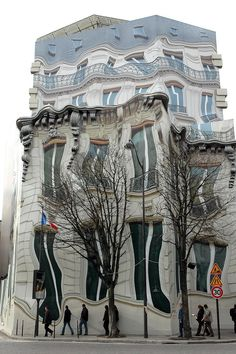 The Hausmannian building on Georges V Avenue in Paris has been referred to as the 'melting building.' It's actually a mural, and an optical illusion referred to as trompe l'oeil (trick the eye).