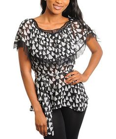 A retro peasant top in contemporary triangle print, this darling piece boasts an added layer of fabric at the collar and delicate lace along the edges. The waistband sash ensures a comfortable and flattering fit.