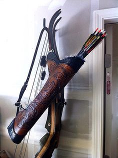 www.pinterest.com/1895gunner/ Nice quiver and some good recurve bows in the background.
