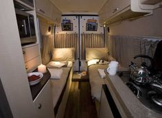 two single beds in a van conversion More
