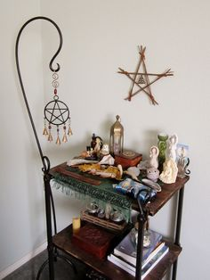 enchanted-wind:  my altar as of this afternoon, with a new star & triquetra decoration my sister made for me last night :)